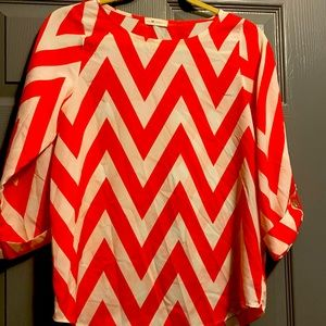 Everly chevron blouse orange and white.